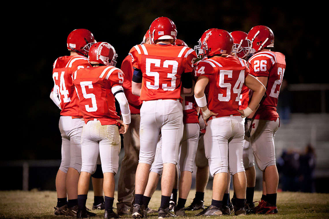An Entire Team Of Teenage Football Players Do Something Very Unexpected Hero Image