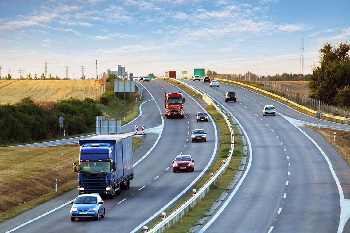 Could a New Federal Speed-Cap Rule Make Driving Near Trucks Safer? Hero Image